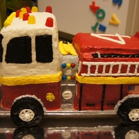 Fire Engine I built a base and covered it with aluminum foil. I used a 15x11 inch cake pan and 2-2/3 cake mixes. Once completely cooled, I cut it apart...
