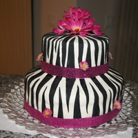 "Pink Zebra Cake This was made with 2 - 9"" and 2 - 6"" round cake pans. The cakes were pink and dark brown zebra print inside. I made white cake..."