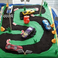 "#5 Race Track My son wanted a Ford Mustang race track cake for his 5th birthday...This is a 15x11"" cake. Green frosting made with the Crusting..."