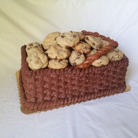 A Basket Full Of Cookies! Chocolate cake with chocolate buttercream basket weave topped with wonderful chocolate chip cookies.