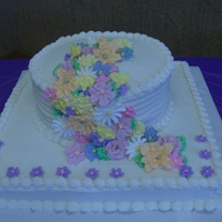 Grandma's 82Nd Birthday Cake Royal Icing flowers in pale colors. Cake & frosting is vanilla
