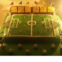 Football Pitch done for a boys birthday, football pitch with players, 2 stands with crowd and flags.
