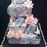 Vintage Love Letter Wedding Cake Wanted to create something unique and different. Roses are made from fondant no cutters free hand.Hand painted the love letters.