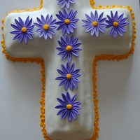 Cross Easter Cake   The design is from Wilton.com. The flowers are a mix of gum paste and fondant.