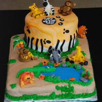 Jungle Themed Cake All animals, rocks and other decoration are made of fondant, grass is buttercream icing. The base cake is chocolate covered in MMF and the...