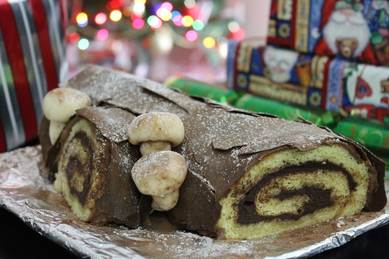 A Christmas Tradition  Traditional yule log cake for Christmas dinner. Vanilla flavored swiss roll filled with kahlua flavored ganache and then iced with mocha...