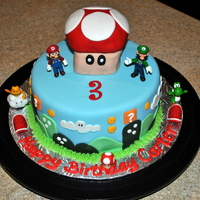 Super Mario Brothers Cake 8 inch Super Mario Brothers Cake with Mario Mushroom on top made from Rice Krispie Treats!