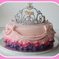 Fit For A Princess White chocolate mud cake with strawberry buttercream fillingTiara made from Piped Royal Icing.