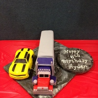 Transformer Prime Cake I made this cake for my 6 year old. He LOVES the Transformers. The Camero and the semi truck's cab are made out of rice krispies and...