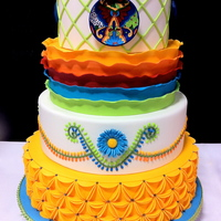 Mexican Wedding Cake I entered this in a cake competition. I was inspired by all of the bright, beautiful colors found in Mexican pottery. I couldn't...