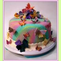 Spring Butterfly Cake Decorated with fondant flowers and butterflies, each hand painted. inside the cake is 2 layers filled with butter-cream and a raspberry...