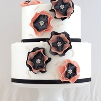 2 Tier Ruffle Flower Cake 2 Tier cakehand made ruffle flowers, sugar pearls and airbrushed with white shimmer