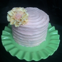 Ruffled Pink Sugar Flower Cake A red velvet cake with a pink cream cheese frosting.