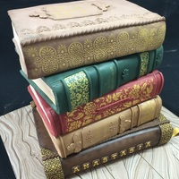 Vintage Books Cake Five chocolate cakes filled with ganache and stacked. Stenciled and handpainted.