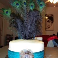Peacock Bridal Shower Cake Basic yellow cake with buttercream icing covered in white fondant. Feathers and ribbon were not edible. It was the first time I had used...
