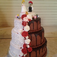 Peach And Mario  Peach & Mario wedding cake for a fun-loving, sweet couple. The figures are molded and hand painted by my wonderful daughter. One of the...