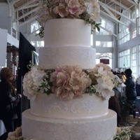 Massive Magesty 6 tier Fondant Round Wedding Cake, Stenciled and separated with hydrangea flowers.