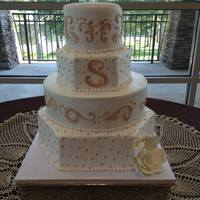 Buttercream Dreams *4 tier round and hexagon wedding cake with Swiss dots & scrolls. All in buttercream--By Simply Southern Specialties