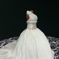 Mini Wedding Dress Cake Front of wedding dress cake.Vanilla cake (serves 1-2) with buttercream covered in fondant.