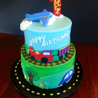 Planes, Trains And Automobiles! 6-in and 8-in chocolate with chocolate buttercream filling and white cake with buttercream filling. Covered in buttercream with fondant...