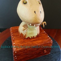 "T-Rex Grooms Cake 8"" square cake with body made from carved 8"" and 6"" round cake. Head made from carved 8"" and 6"" round cake. It was..."