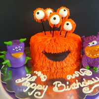 Orange Monster Cake Chocolate cake with peanut butter filling. Orange buttercream with fondant white eyes with orange buttercream. Two purple monsters are...