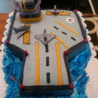 Aircraft Carrier Fondant tower, air strips and jets and the rest in buttercream
