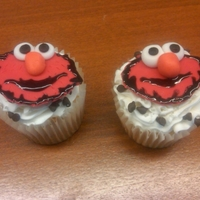 Elmo Cupcakes Elmo cupcakes - Elmo made from fondant with almond buttercream frosting and chocolate chips