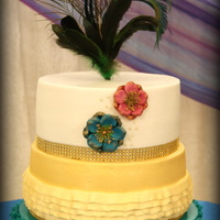Quinceanera / Sweet 16 Cakes  Peacock themed sweet 16 cake done entirely in buttercream other than gold bling ribbon, flowers and feather. Bottom tier turquoise...
