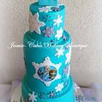 "Frozen Themed Cake For My Daughter All Buttercream W Fondant Accents And Gumpaste Topper Middle Double Barrel Tier   Frozen themed cake for my daughter. All buttercream w/ fondant accents and gumpaste topper. Middle ""double barrel"" tier."