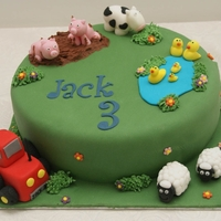 Farm Yard Cake Fun farm scene with cows, pigs, sheep, ducks and tractor!