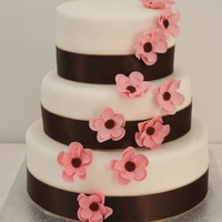 Brown And Pastel Pink Wedding Cake Cake donated to a Breast Cancer fund raiser. Delicate pink flowers cascading down a simple white cake
