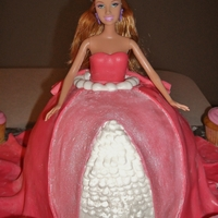 Barbie Cake  The inside of dress is made with layers of rainbow and strawberry cake with buttercream filling. The outer part of dress is made with...