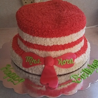 Cat In The Hat Themed Cake This cake is covered in butter cream and has a fondant bow tie