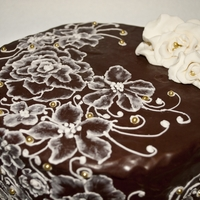 Death By Chocolate Brush embroidery piping over dark chocolate ganache on a double chocolate amaretto and italian almond cake.