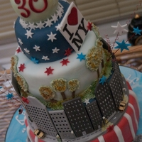 New York Cake 5 Tier New York Scene CakeVanilla Sponge & Chocolate SpongeEverything aside from the wire is edible. Hand-painted sugar Statue of...