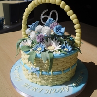 Flower Basket All edible handcrafted sugar flowers with a piped buttercream basket.