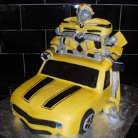 'bumblebee' Transformer Cake Car and chest of robot is all sponge, the shoulders and head are sculpted sugarpaste :)