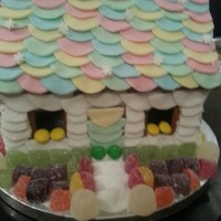 Gingerbread House Decorated With Sweets And Fondant   Gingerbread House decorated with sweets and fondant.