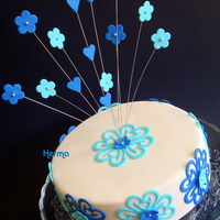 Blue Lacy Hearts! Blue Lacy Hearts on white fondant cake with wire-fountain.