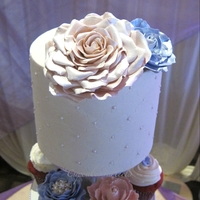 Wedding Cake With Pink And Lavender Sugar Flowers On Wedding Cupcake Tower Wedding cupcake tower cake with pink and lavender sugar roses. There's also 350 cupcakes on the cupcake tower and in the kitchen of...