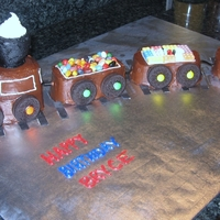 Train Cake Made by Elicia H. for a little boy celebrating his 2nd Bday. He is our cover photo on our website.