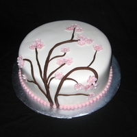 Cherry Blossom Cake Made by Elicia H of our Santa Cruz County chapter. Cherry blossoms made out of gumpaste.