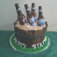 Beer Bucket Cake It's a 3 layer Marble Cake with Chocolate Gnache Filling and Peanut Butter Buttercream. Sugar beer bottles and ice. Everything edible...