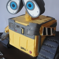Wall - E I made this cake for my sons birthday. The body is cake, the head made out of carved styrofoam and the wheels are moulded from rice cripies...