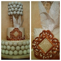 "20's Cake Ball Cake This Cake Ball Cake has hanging sugar beads, rice paper feathers and a gumpaste ""brooch"". And of course, cake balls :) I made..."