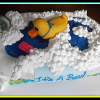 Rubber Ducky Baby Shower Cake This is a baby shower cake I made. Everything on the cake is edible. YUM!
