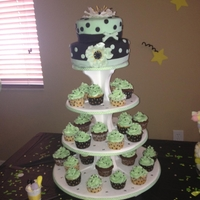 Baby Shower   Black and light greeen cake and cupcakes.