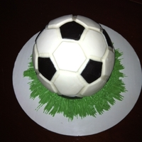 Caleb's Soccer Ball Made for grandson's 6th birthday. Sports ball filled with SMBC, crumb coated with vanilla buttercream, covered in fondant with fondant...