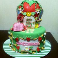 Strawberry Shortcake Birthday Cake A Strawberry Shortcake house cake made for a little girl's birthday. Strawberry Shortcake is made from a mini doll with a cupcake...